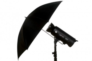 Reflective umbrellas bounce the light back onto the subject